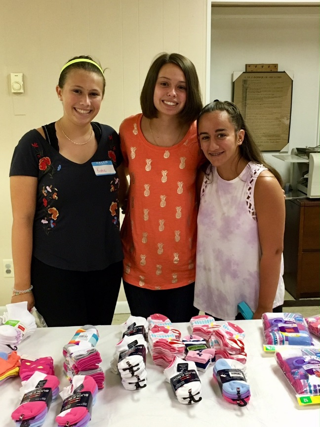 Girl Scouts Kate Delmonico, Samantha Osborne, and Cristina Maffei
