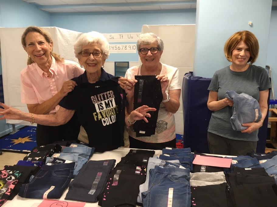 Ilene Monahan, Jackie Gershman, Sue Rosenthal and Melanie Levitan setting up the store
